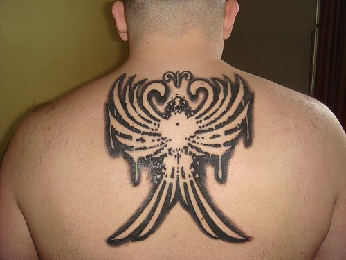 Rising phoenix tattoo on back