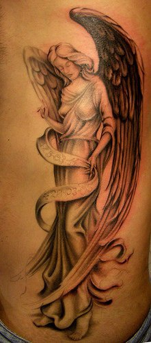 Angel with fly-away clothes on tattoo