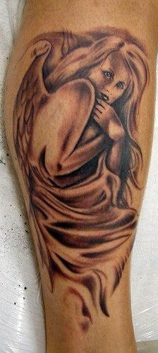 Frighten angel in cloak tattoo