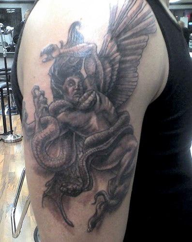 Fallen angel fighting with serpent
