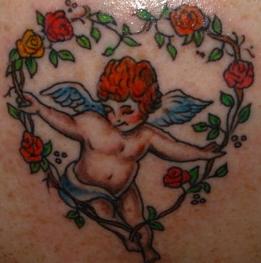 Cherub in heart of roses coloured tattoo