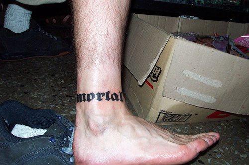 Inscription bangle ankle tattoo