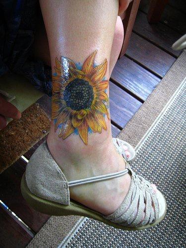 Designed sun-flower ankle tattoo