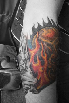 Monster near the  fire arm tattoo