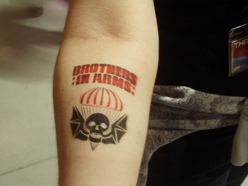 brothers in arms arm tattoo