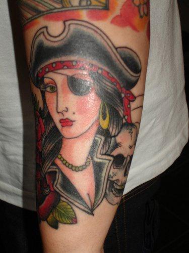 Pirate woman arm tattoo