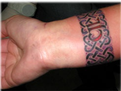 Celtic tracery wrist tattoo