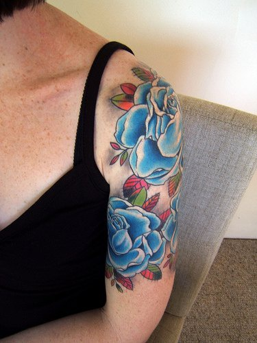 Blue roses arm tattoo