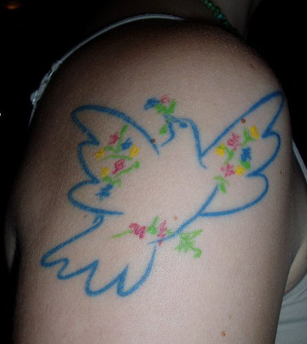 Pigeon arm tattoo
