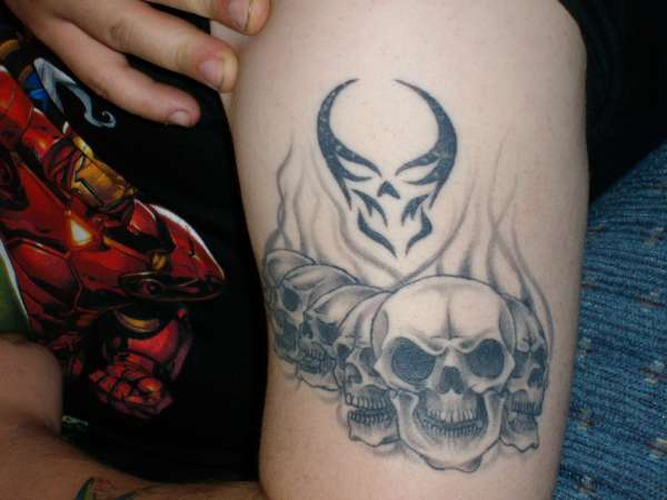 Skulls in flames black tattoo