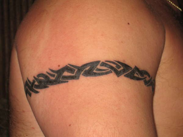 Small tribal arm band on shoulder