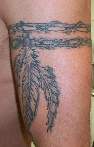 Black and white feathers on arm band