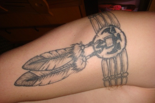 Incomplete indian arm band with feather