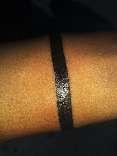 Black work stripe arm band tattoo