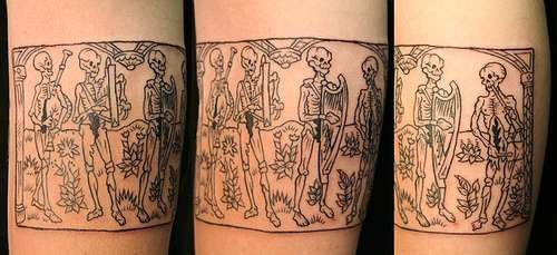 Danse macabre arm tattoo