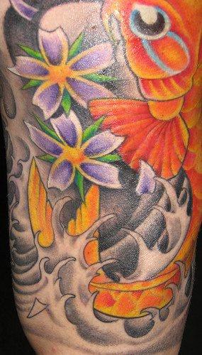 Close view koi sleeve tattoo