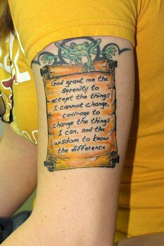 Wise inscription designed arm tattoo