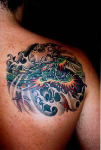 Asian dragon in sea tattoo on shoulder
