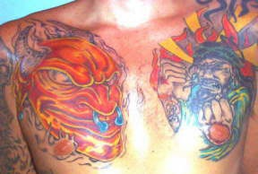 Two japanese demons fight tattoo on chest