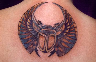 Sacred scarab coloured tattoo