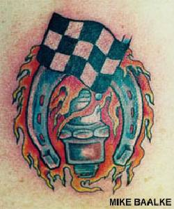 Racing flag with flaming horseshoe tattoo