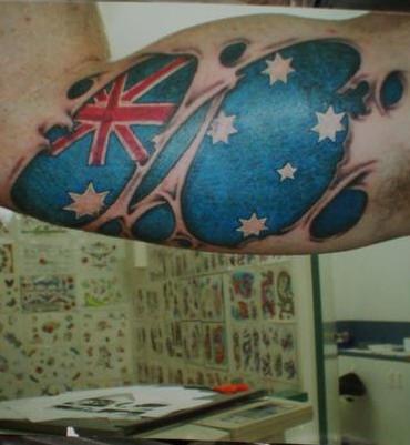 Australian flag skin rip tattoo
