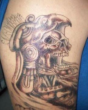 Aztec stylized dead man tattoo