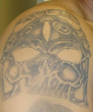 Primitive aztec skull tattoo