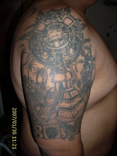 062bbe79f4342 Sun stone and aztec pyramid on shoulder - Tattooimages.biz