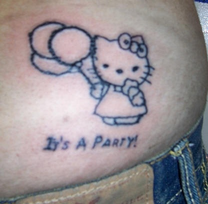 Hello kitty backside tattoo