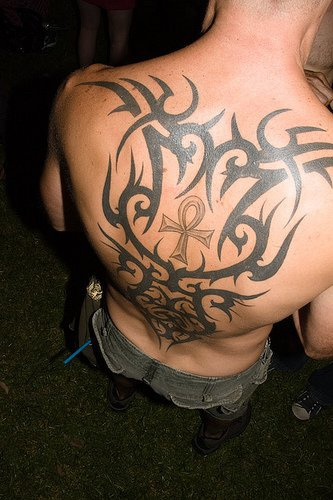 Cross  tattoo upper back in black pattern