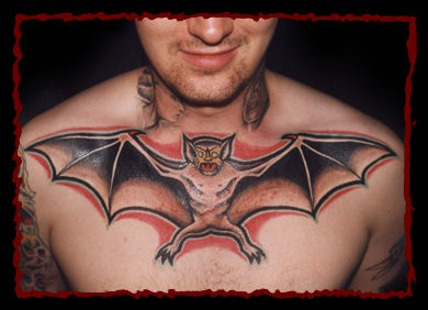 Large flying bat tattoo on chest