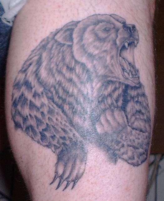 Roaring bear realistic tattoo