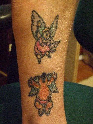 angelo orso e signora grassa tatuaggio