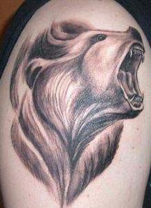 Roaring realistic bear tattoo