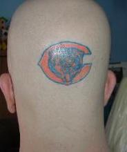 Bear team logo tattoo on head