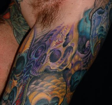 cranio biomech sul braccio tatuaggio