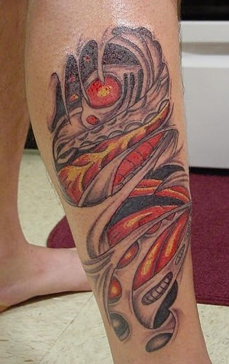 Red biomechanical leg  tattoo