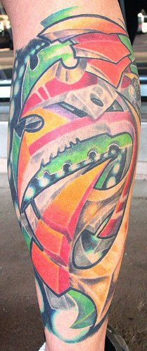 Surreal coloured tattoo on leg