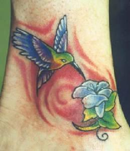 Hummingbird with flower coloured tattoo