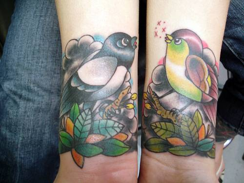 Two birds tweeting on both wrists