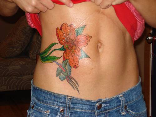 Colourful tattoo with birds and flowers