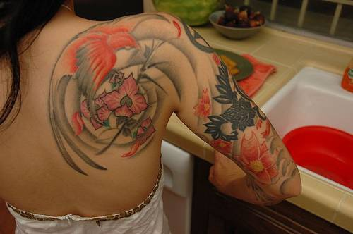Amazing bird themed artwork tattoo