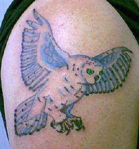 Polar owl in flight tattoo