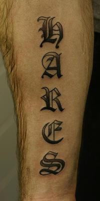 Name black text tattoo