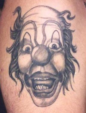 Evil black clown tattoo