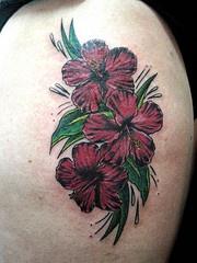 Dark red hibiscus tattoo