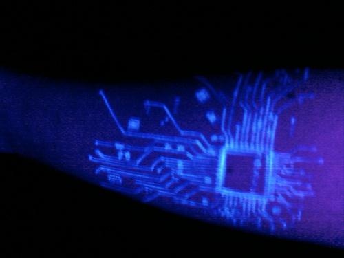 Digital board glowing tattoo