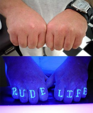Rude life uv ink knuckles tattoo