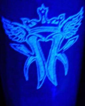 Crown glowing ink tattoo
